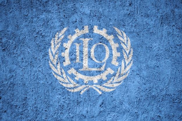 International labour organization flag painted on grunge wall