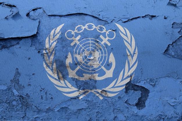 International maritime organization flag painted on grunge cracked wall