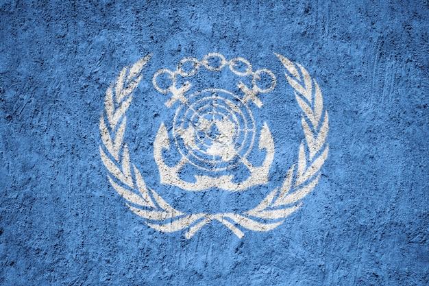 International maritime organization flag painted on grunge wall