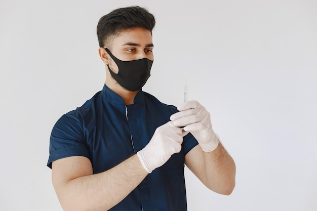 International medical student. man in a blue uniform. doctor in a mask.