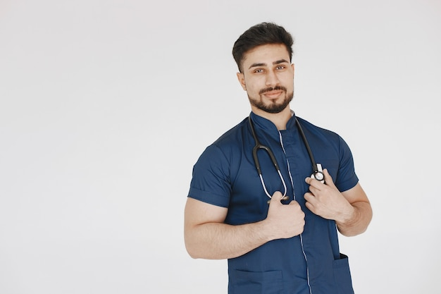 International medical student. man in a blue uniform. doctor with stethoscope.