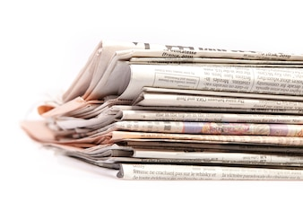 International newspapers on white.