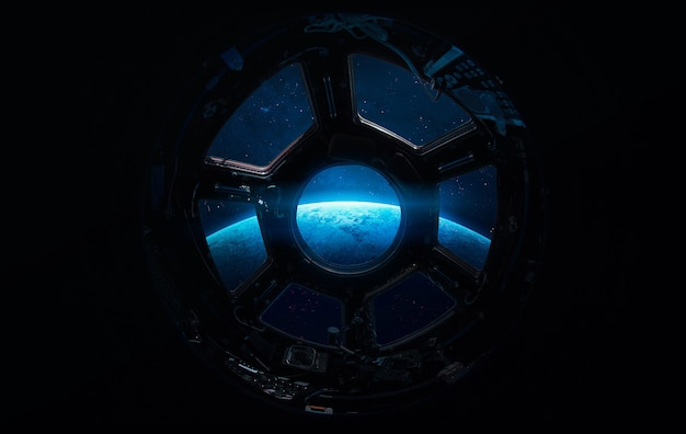 International space station on orbit of the earth planet. view from porthole. iss.elements of this image furnished by nasa