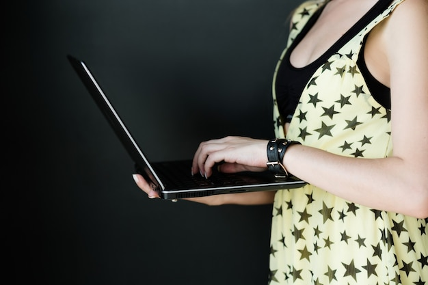 Internet business and e-commerce. online digital marketing. make money on the web. woman holding a laptop.