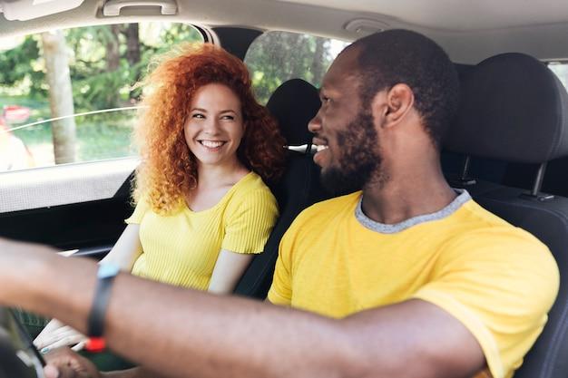 Interracial couple on a car trip