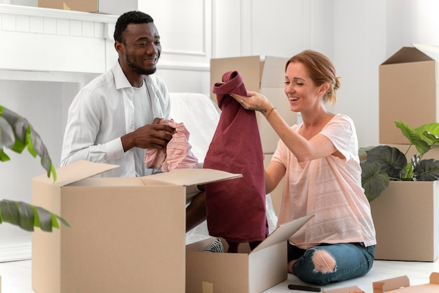 Interracial couple getting ready to move