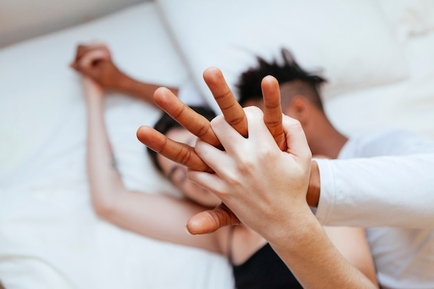 Interracial couple holding hands at home. millennial young love between two different races.