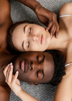 Interracial couple posing with closed eyes