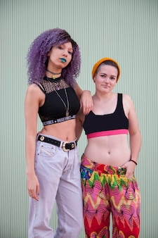 Interracial homosexual couple of young teenagers with colorful clothes