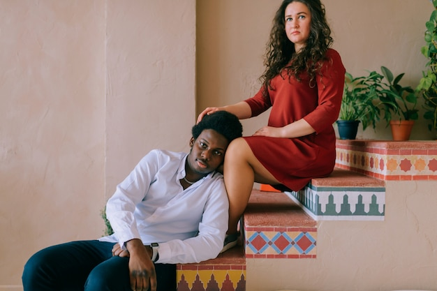 Interracial loving couple lifestyle indoor portrait.