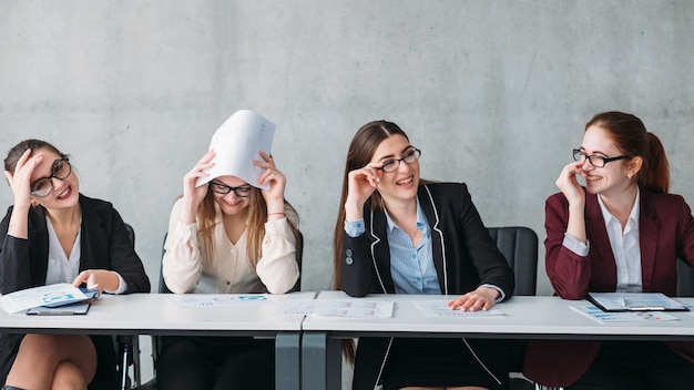 Interview failure. rejection. corporate committee females laughing at virtual job applicant.
