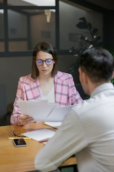 Interview or negotiation successful and beautiful business woman in her office interview