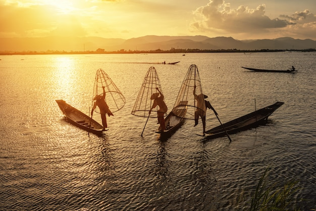 Intha fishermen working in the morning.