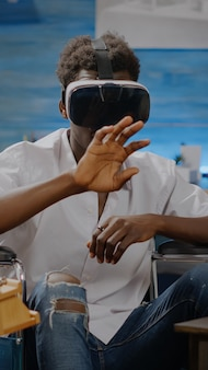 Invalid african american person using vr goggles for fine art