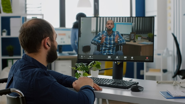 Invalid freelancer talking on videocall with remote coworker