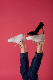 Inverted foot black shoe fashion modern style pink background