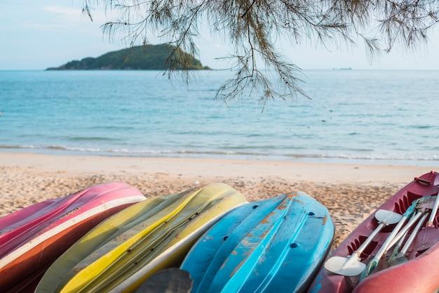 Inverted kayaks on sea shore