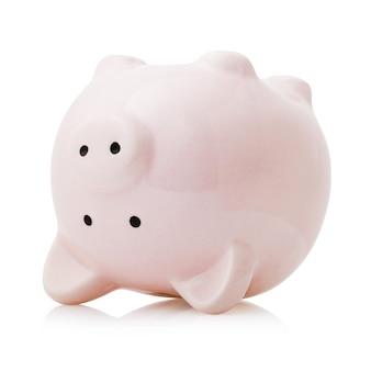 白い背景で隔離の逆ピンクセラミック貯金箱