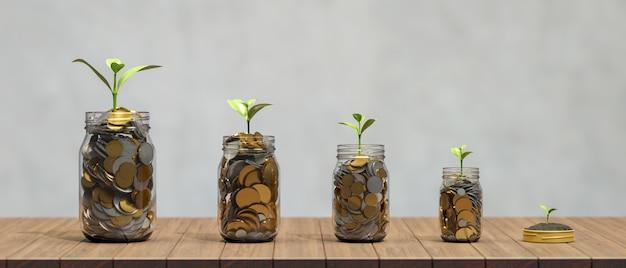 투자 및 나무 테이블에 식물 성장 유리 항아리에 돈 개념 황금 동전을 절약