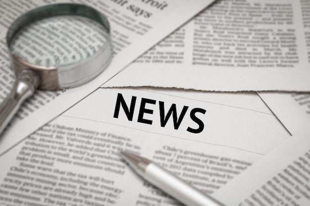 Investment headline on newspaper background
