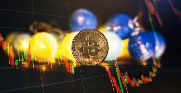 Инвестиционная платформа с графиками и биткойн-монетой. биткойн btc криптовалютные монеты. концепция фондового рынка.