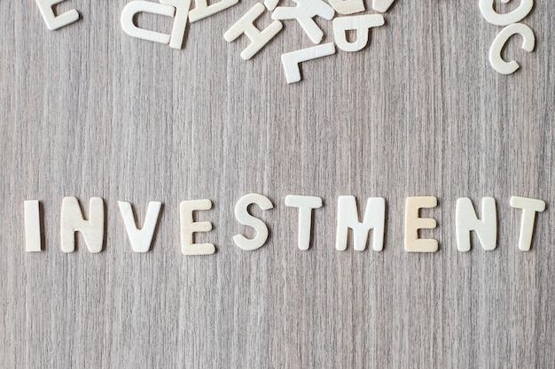Investment word of wooden alphabet letters. business and idea concept
