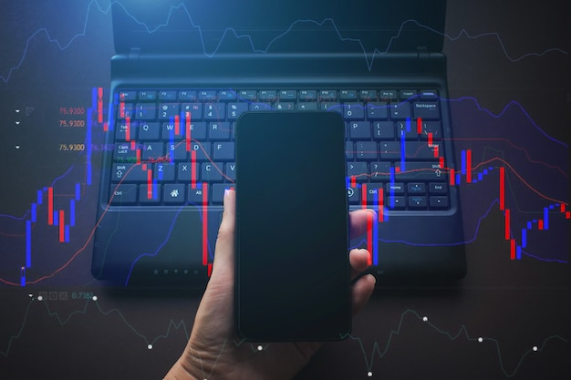 Investor analyzing stock market investments using smartphone. making trading online on the smart phone. mobility, business and finance concept.