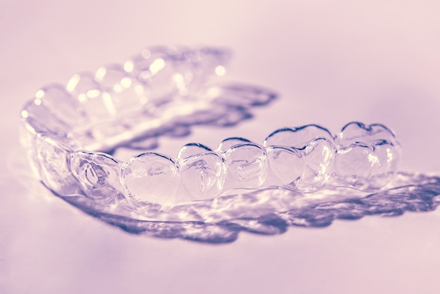 Invisible dental teeth brackets tooth aligners. plastic braces dentistry retainers to straighten teeth.