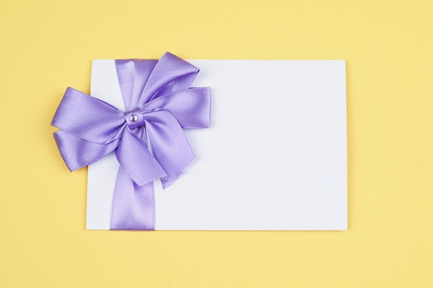 Invitation card with bow for holiday.