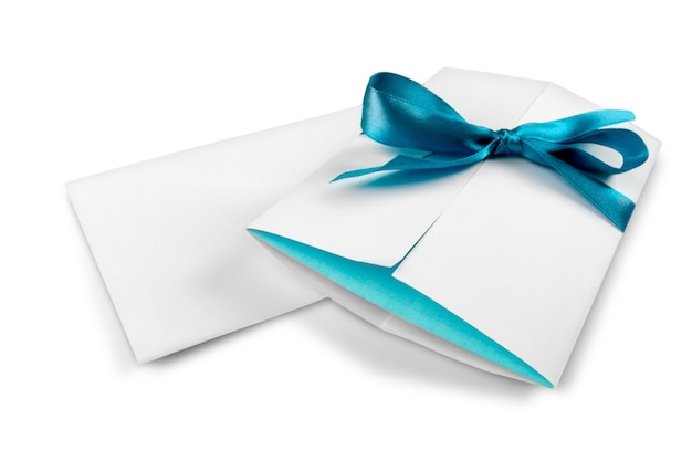 Invitation envelope with blue bow and blank letter isolated on white