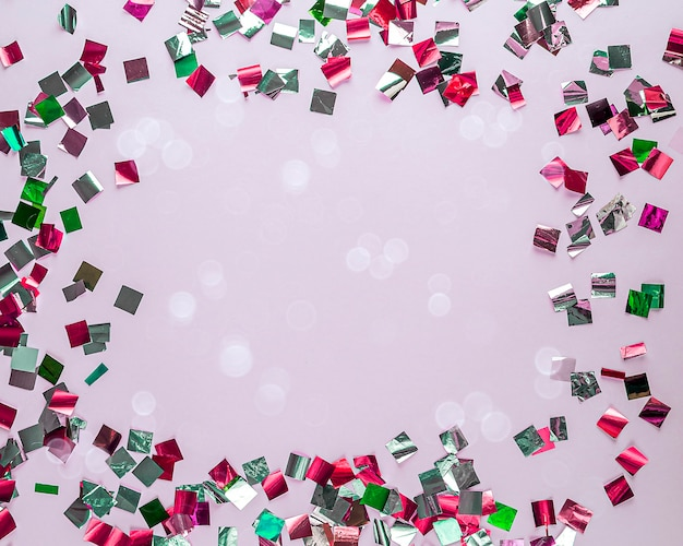 Invitation gretting cards mock up . party colorful glitter confetti or sequins and bokeh on pink.