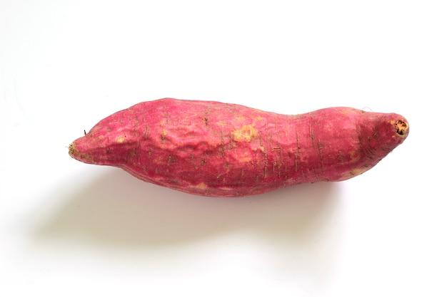 Ipomoea batatas on a white scene.