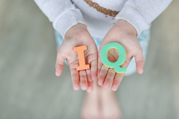 Iq (intelligence quotient) sponge text on child hands