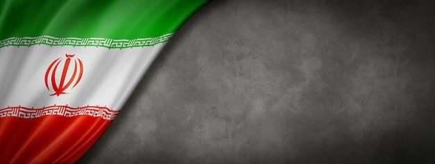 Iran flag on concrete wall. horizontal panoramic banner. 3d illustration
