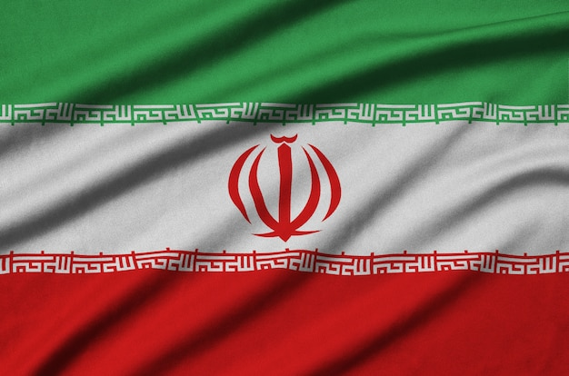 Iran flag  is depicted on a sports cloth fabric with many folds.