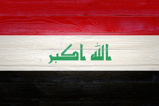 Iraq flag painted on wooden planks
