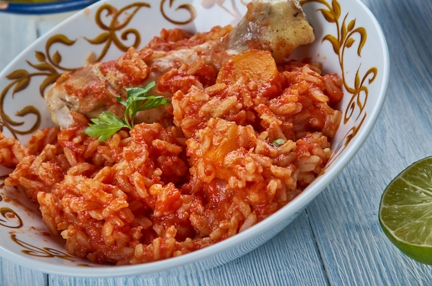 Iraqi chicken with red rice, asia traditional assorted dishes, top view.