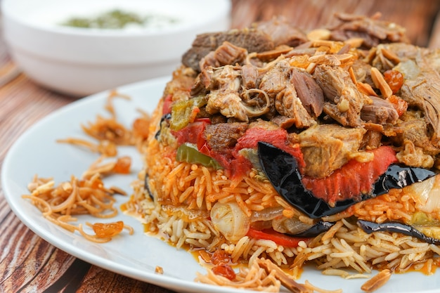 Iraqi maqlooba rice on a white plate