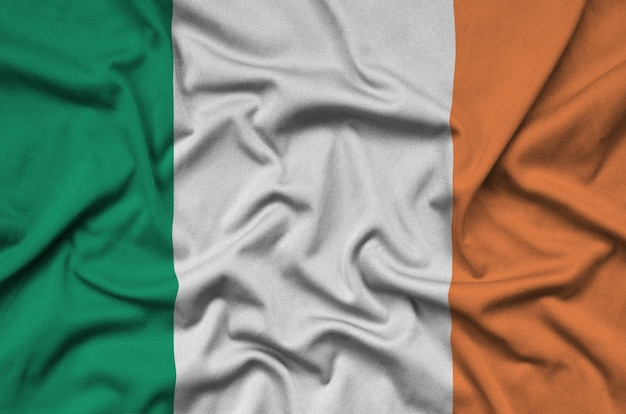 Ireland flag  is depicted on a sports cloth fabric with many folds.