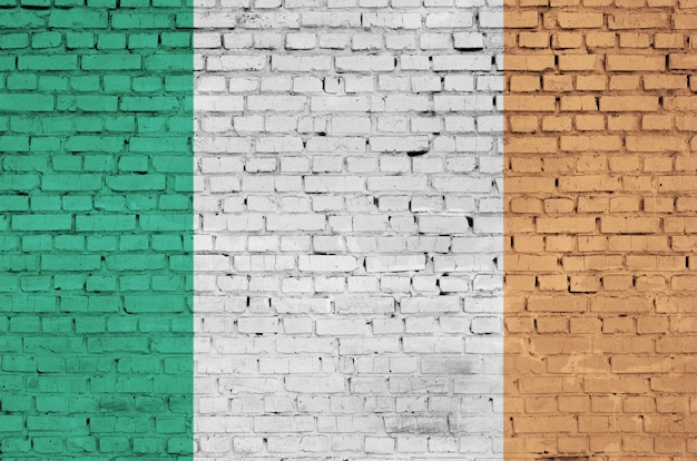 Ireland flag is painted onto an old brick wall
