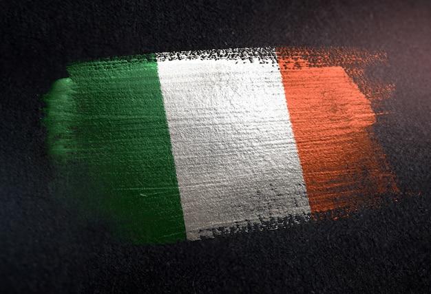 Ireland flag made of metallic brush paint on grunge dark wall