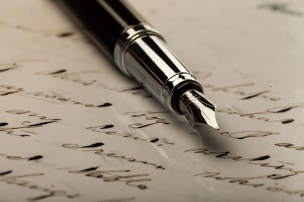 Iridium point fountain pen lying on the letter - close up