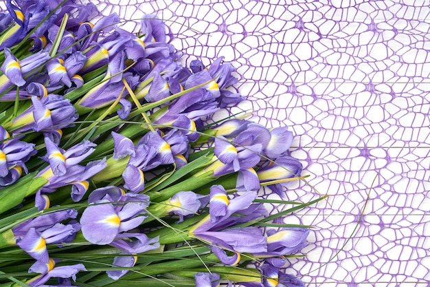 Iris bouquet on decorative tablecloth.