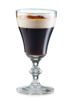Irish coffee in a glass isolated on white