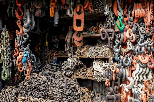 Iron chains with hooks lie and hang on the shop. a device for loading and unloading goods.