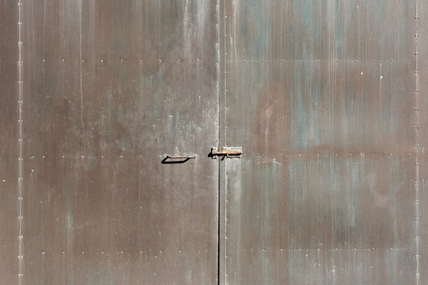 Iron door texture, rust, with red, blue, brown colors, plates glued with rivets