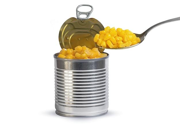 白地に缶詰のトウモロコシと鉄の瓶と大さじ