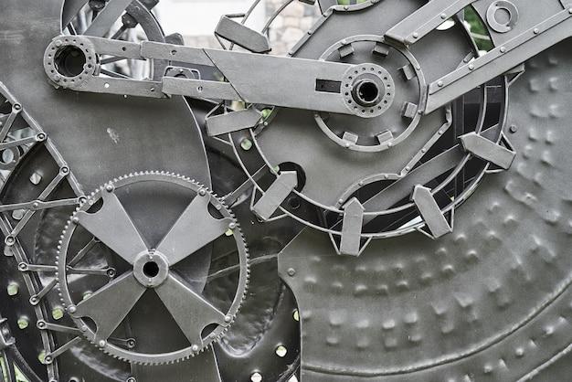 鉄の機械部品と歯車の背景。スチームパンクなテクスチャ