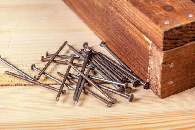 Iron nails on a wooden table