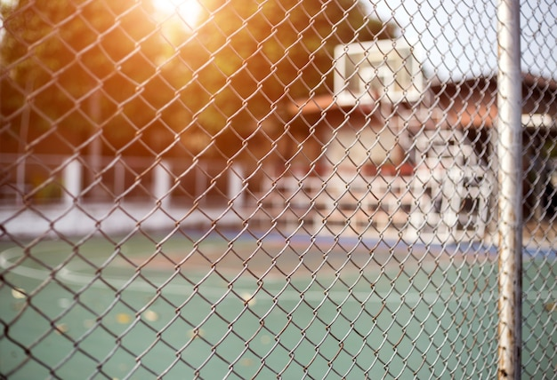 Iron net fence fron of basketball court